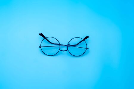 Designer sunglasses on blue background