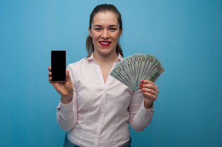 Charming cheerful young woman holding a bundle Stock Photo - 135777426