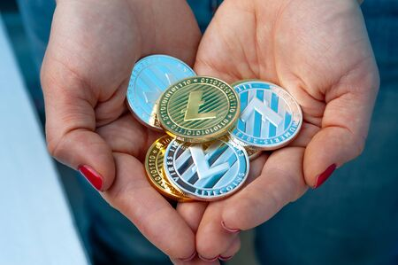 Unidentified woman holding a handful of bitcoin Stock Photo - 135777428