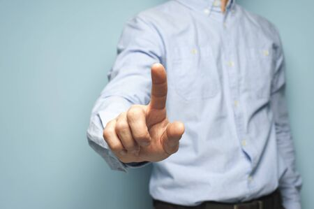 Unidentified man clicks his fingers on an invisible screen Stock Photo - 135777430