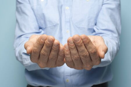 Close-up hands of an unidentified man Stock Photo - 135777431