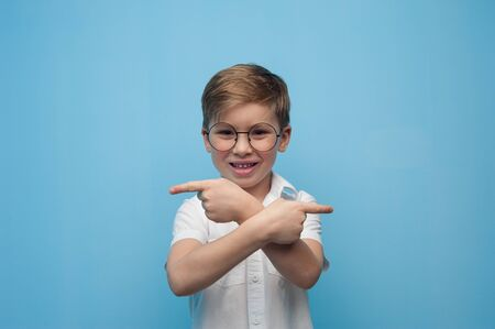 Cheerful cute little boy in glasses Stock Photo - 136181960