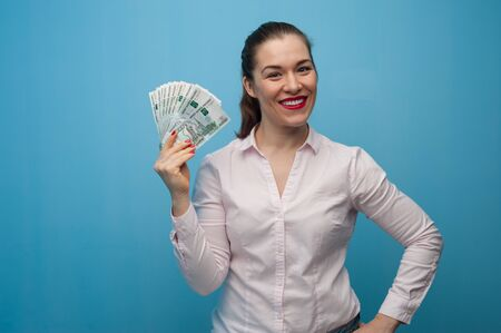 Happy young emotional caucasian woman with rubles Фото со стока