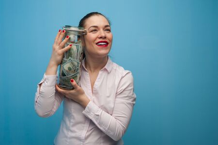 Young charming woman holds a jar