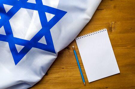 Fag of Israel notepad pencil and notes
