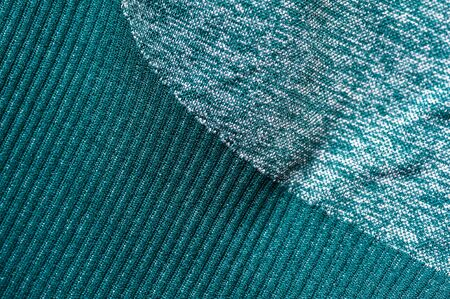 Close-up fragment of a green womens nylon sports wear. concept of quality sportswear. Advertising space. Advertising concept 写真素材