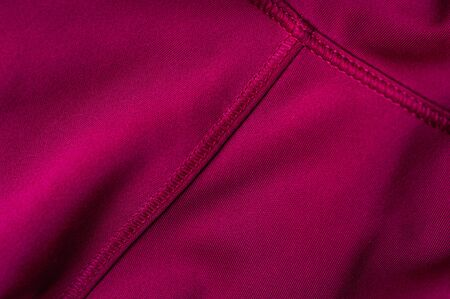 Close-up fragment of pink nylon garment. The concept of quality clothing. Place for advertising. Advertising concept
