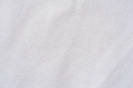 Close-up fragment of light cotton linen fabric. Concept of quality fabric for sewing clothes. Advertising space. Place for text