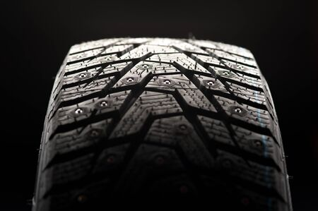 Close-up of a car tire standing upright