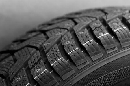 Fragment of a car studded tire Banco de Imagens