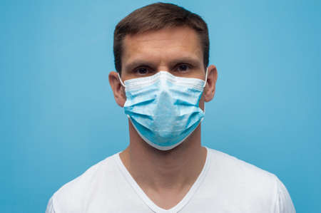 Portrait of man wearing an anti virus protection mask to prevent  virus.