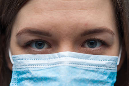 Close-up Portrait of Woman wearing an anti virus protection mask to prevent virus