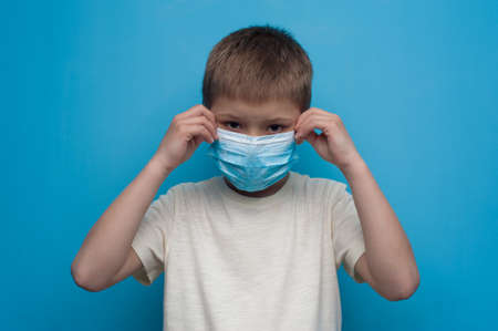Portrait of child wearing an anti virus protection mask to prevent virus. Imagens