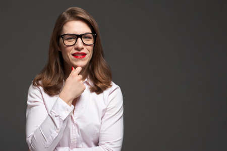 Portrait of attractive office woman with stylish eyeglasses and red lips. Place for design.