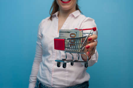 Young woman holding a toy grocery basket