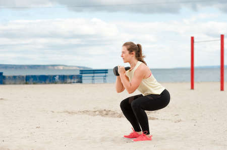 Athletic young woman during beach workout. Imagens