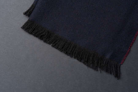 Close-up fragment of warm scarf. Concept of warm everyday things. clothing store concept. Advertising space. Imagens
