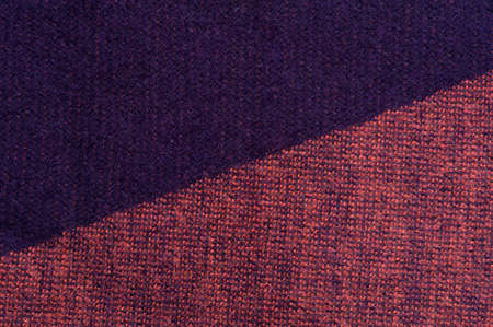 Close-up fragment of warm knitted printed sweatshirts. Concept of warm everyday things. clothing store concept. Advertising space. Place for text Imagens