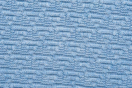 Close-up fragment of warm knitted blue sweatshirts. Concept of warm everyday things. clothing store concept. Advertising space