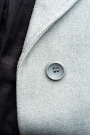 Detail of light blue female coat. Concept of warm everyday things.