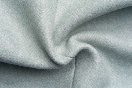 Close-up fragment of warm woolen fabric. Concept of warm everyday things.