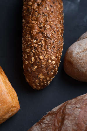 Flat lay bread background. Freshly baked assortment of bread.