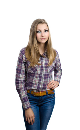 women jeans: Young blond woman in jeans and a plaid shirt standing on a white background  Student looks forward  Stock Photo