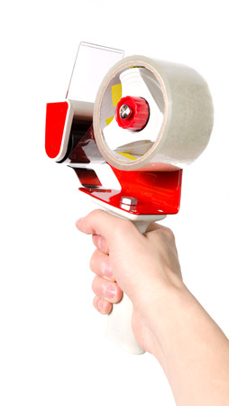 Dispenser (holder) for an adhesive tape with a red pen and transparent tape in hand on a white background.