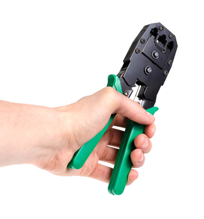 crimping: Crimping Tools group for internet cable on a white background with green handles.
