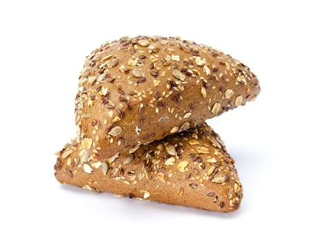 Two dark triangular buns with sunflower seeds, flax and sesame seeds on a white background. Archivio Fotografico