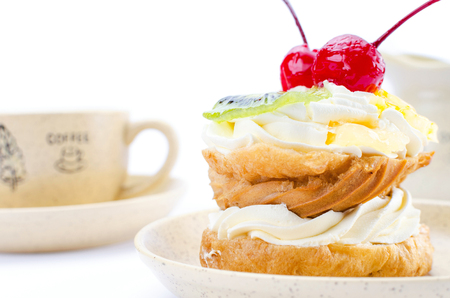 Choux pastry with fruit with a cup of coffee.