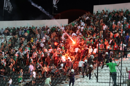 THESSALONIKI, GREECE-AUG 23,2012:Clashes PAOK Thessaloniki and Rapid Vienna fans and the police before UEFA Europe League Playoff Football Match at Toumba Stadium