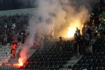 riots: THESSALONIKI, GREECE-AUG 23, 2012:Clashes PAOK Thessaloniki and Rapid Vienna fans and the police before UEFA Europe League Playoff Football Match at Toumba Stadium