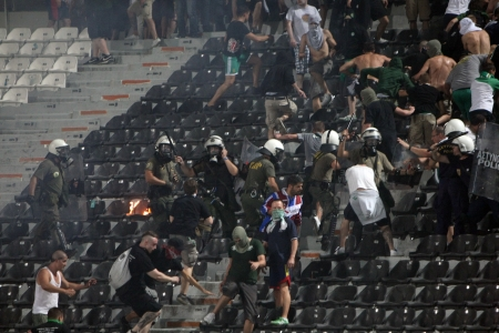 THESSALONIKI, GREECE-AUG 23, 2012:Clashes PAOK Thessaloniki and Rapid Vienna fans and the police before UEFA Europe League Playoff Football Match at Toumba Stadium