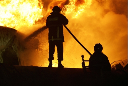 KILKIS,GREECE - MAY 9,2007: Fire-fighters trains extinguishing a fire Stock Photo - 16223985