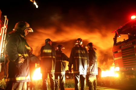 KILKIS,GREECE - MAY 9,2007: Fire-fighters trains extinguishing a fire