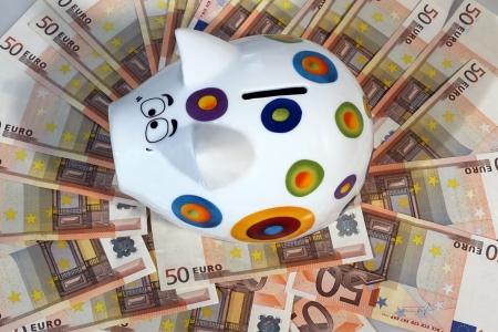 income tax:  Piggy bank on sea of 50 euros