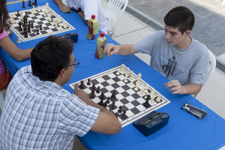 decs: THESSALONIKI,GREECE - OCT 07, 2012:Unidentified players take part at chess tournament marathon of 30 rounds for beginners and experienced chess players in Thessaloniki  Editorial