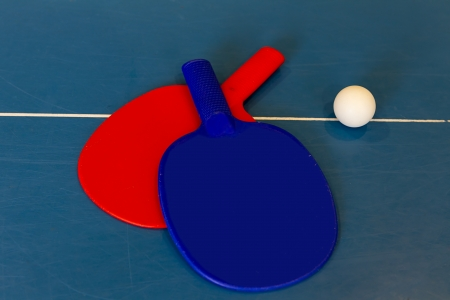 Ping pong paddles and balls photo