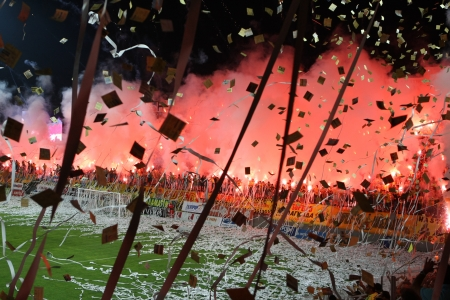 THESSALONIKI, GREECE - AUGUST 5, 2009: Fans and supporters of Aris team light flares in football match between Aris and Boca Juniors cheering for their team goals