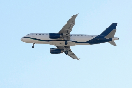 SX-OAR Airbus A320-232 passenger plane flying in the blue sky photo