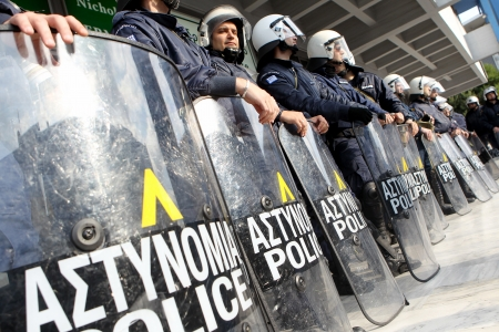 thessaloniki: THESSALONIKI,GREECE - NOV,15 2012 : Municipal workers gesture during a demonstration against the presence of a German deputy labour minister Hans-Joachim Fuchtel, in Thessaloniki on 15 November, 2012