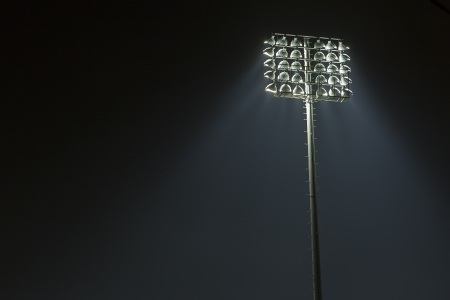 Stadium lights against dark night sky backgroundon