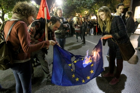 thessaloniki: THESSALONIKI,GREECE - NOV, 17 2012 :Greek students burn a European. flag outside the U.S. embassy in Thessaloniki during a rally marking the 39th anniversary of a 1973