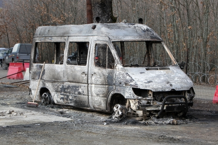 HALKIDIKI,GREECE-FEB,17,2013:Group of 40 men threw molotov cocktails and set fire to equipment at the Hellenic Gold site, damaging containers, cars and trucks, in the northern region of Halkidiki