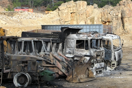 threw: HALKIDIKI,GREECE-FEB,17,2013:Group of 40 men threw molotov cocktails and set fire to equipment at the Hellenic Gold site, damaging containers, cars and trucks, in the northern region of Halkidiki