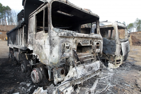 damaging: HALKIDIKI,GREECE-FEB,17,2013:Group of 40 men threw molotov cocktails and set fire to equipment at the Hellenic Gold site, damaging containers, cars and trucks, in the northern region of Halkidiki