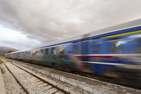Fast train passing on railway station photo