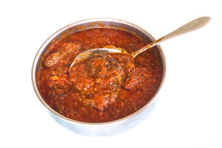 cooked pepper ball: Pot of tomato sauce and meatballs