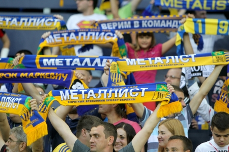 thessaloniki: KHARKIV, UKRAINE -AUG 07:Fans and supporters of METALIST are cheering for their team during the UEFA Champions League soccer match METALIST vs PAOK at Metalist Arena on August 07,2013 in Kharkiv, Ukraine. Editorial
